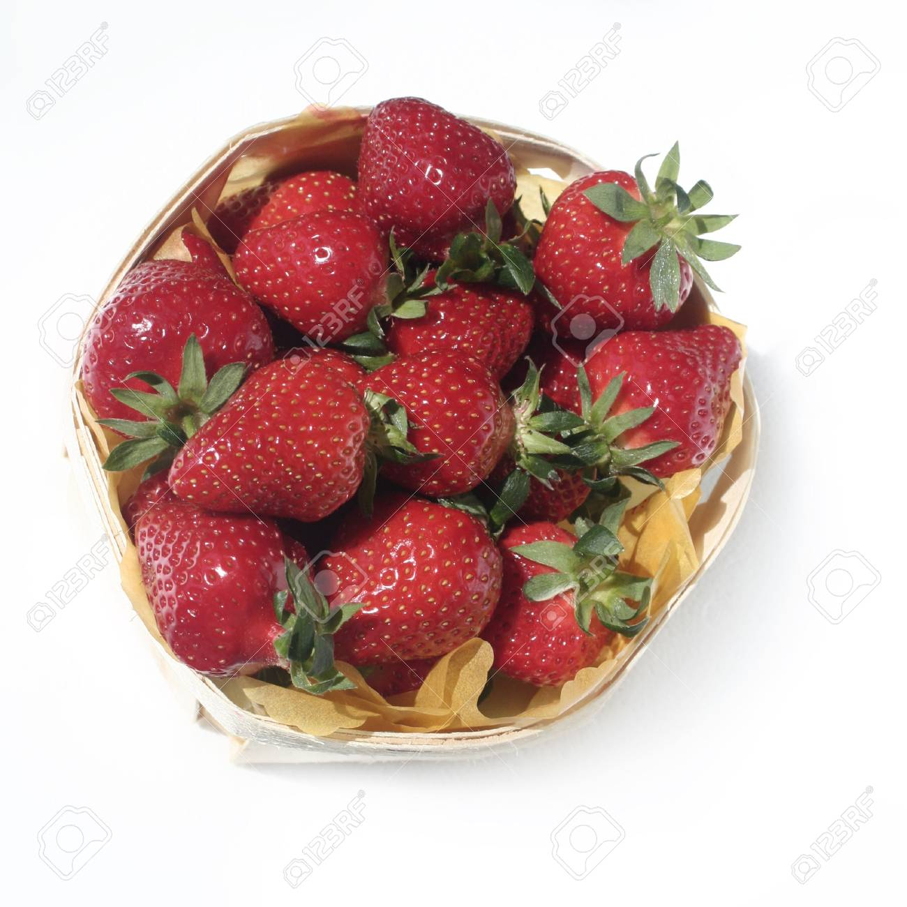 bascket  of strawberries isolated on white Stock Photo - 6817865