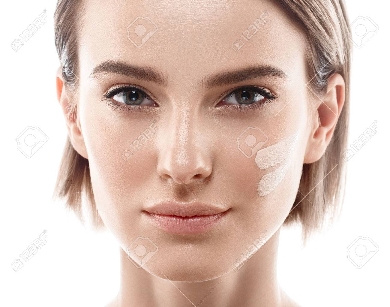 Skin tone cream lines on woman face. Beautiful woman portrait beauty skin healthy and perfect makeup. Studio shot. Isolated on white. - 63467839