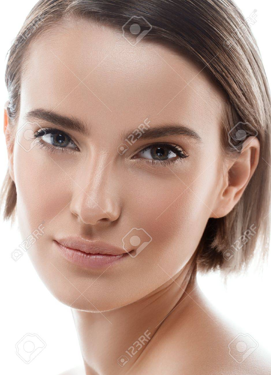 Beauty Woman face Portrait. Beautiful model Girl with Perfect Fresh Clean Skin color lips purple red. Blonde brunette short hair Youth and Skin Care Concept. Isolated on a white background - 63467975