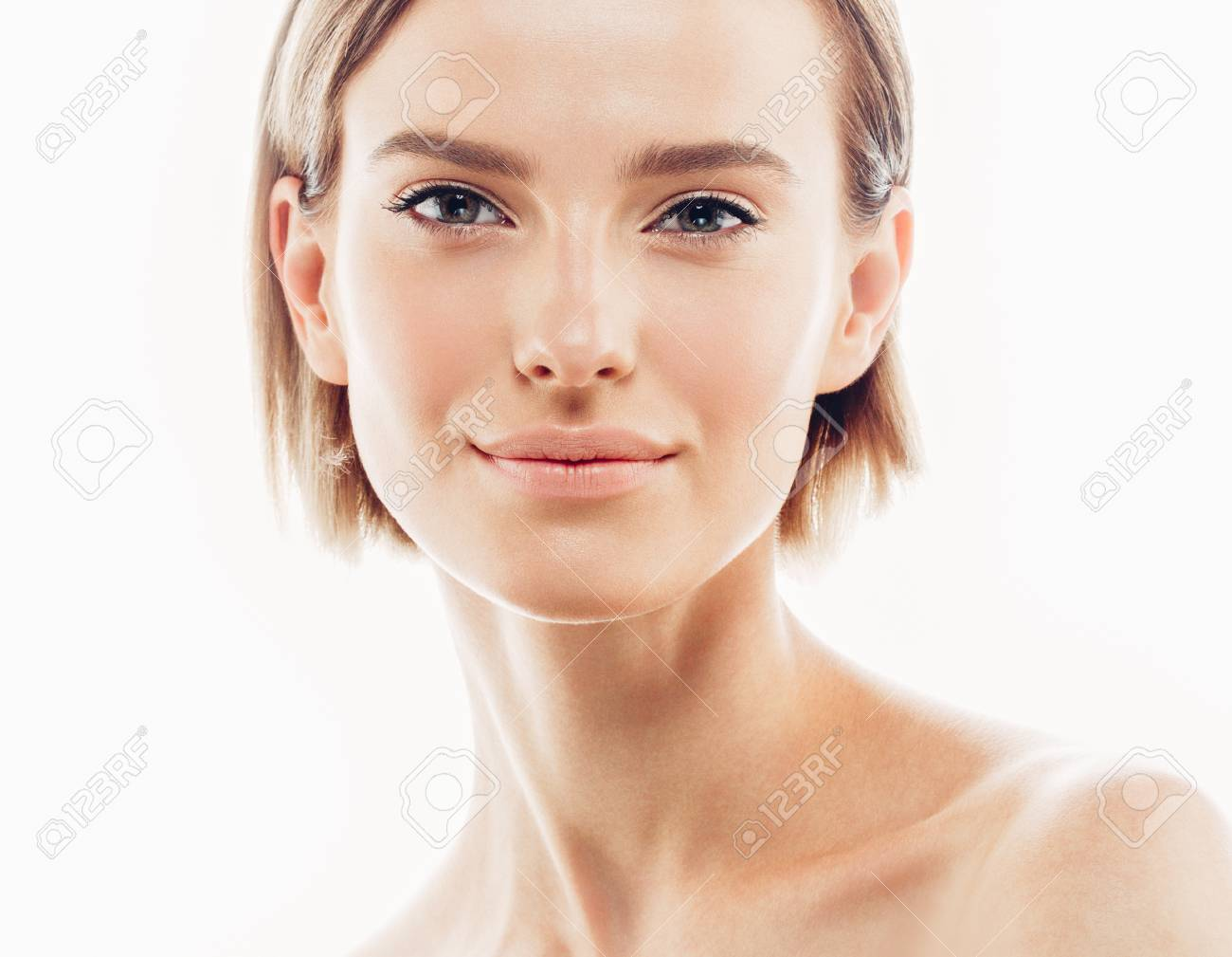 Beauty Woman face Portrait. Beautiful model Girl with Perfect Fresh Clean Skin color lips purple red. Blonde brunette short hair Youth and Skin Care Concept. Isolated on a white background - 66201064
