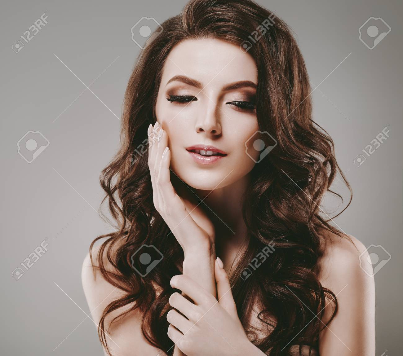 Beautiful Woman With Perfect Make Up And Hairstyle Curly Long