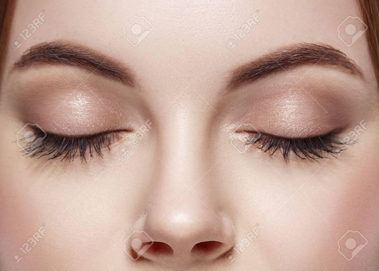 Beautiful woman eyes closed - 62775602