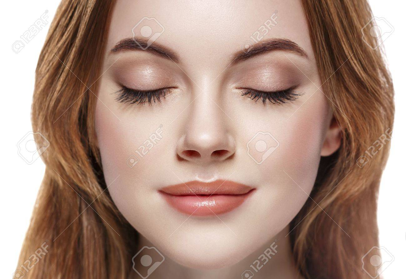 woman closed eye close-up isolated on white. - 62776399