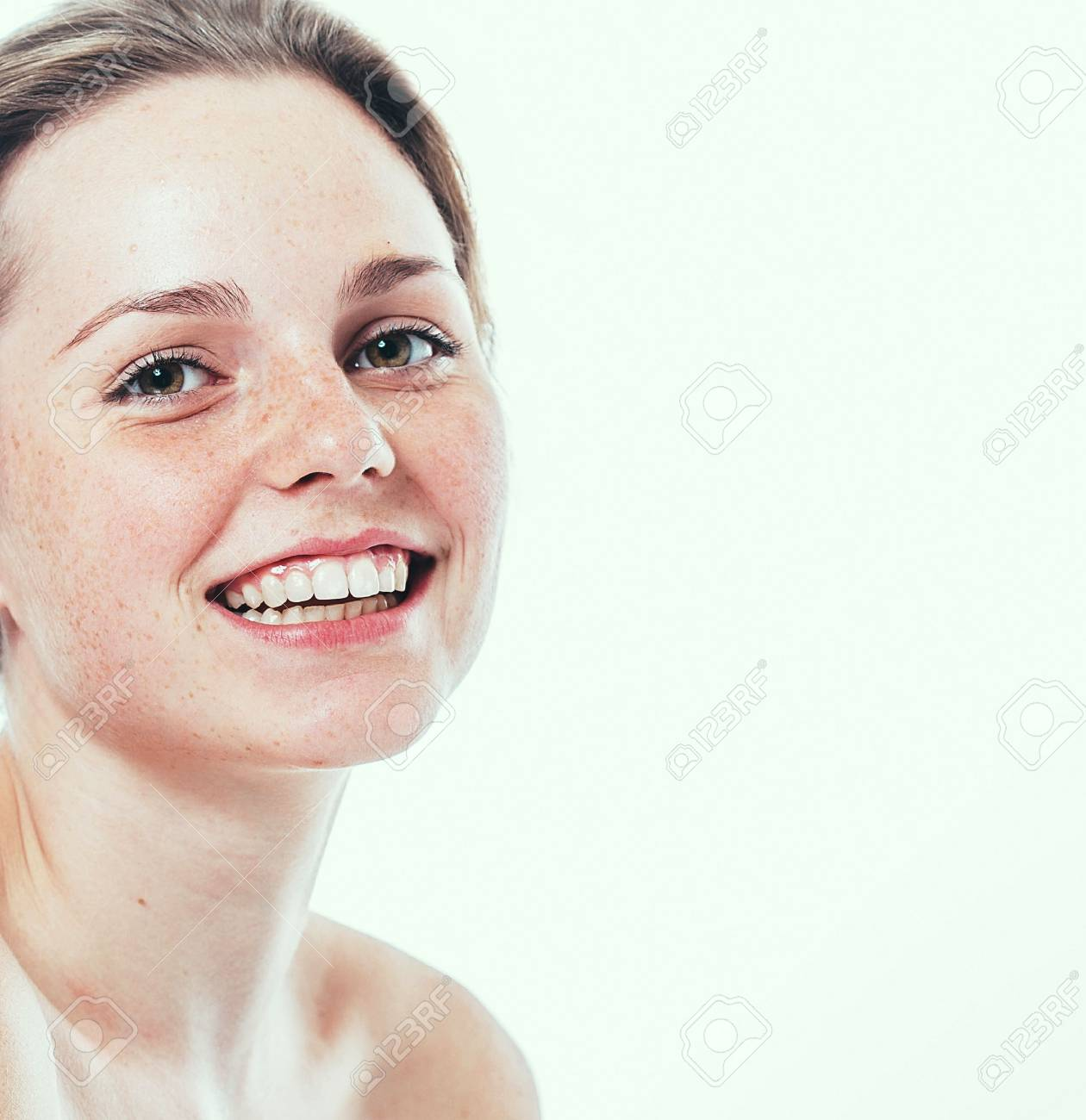 Portrait of smiling young and happy woman with freckles. Isolated on white. - 62771504