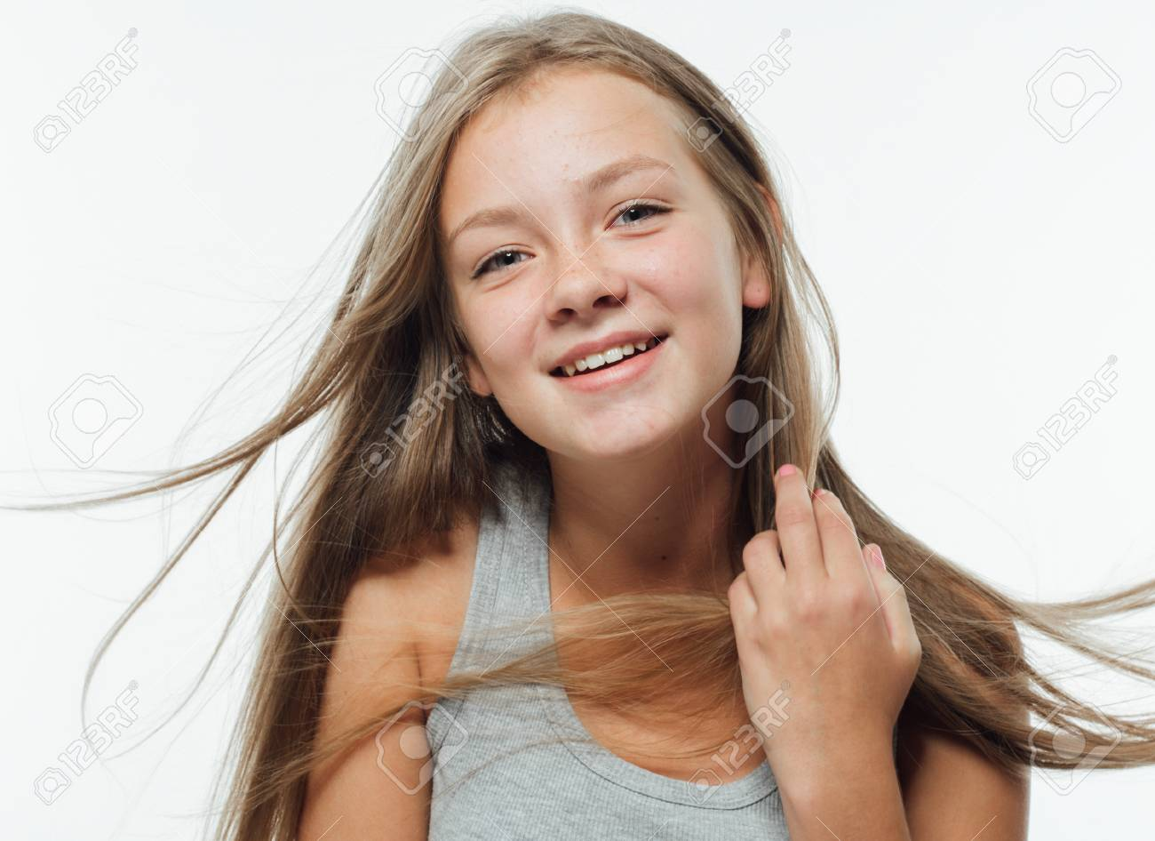 Cute teenage girl freckles woman face closeup portrait with healthy skin. Studio shot. - 79345726