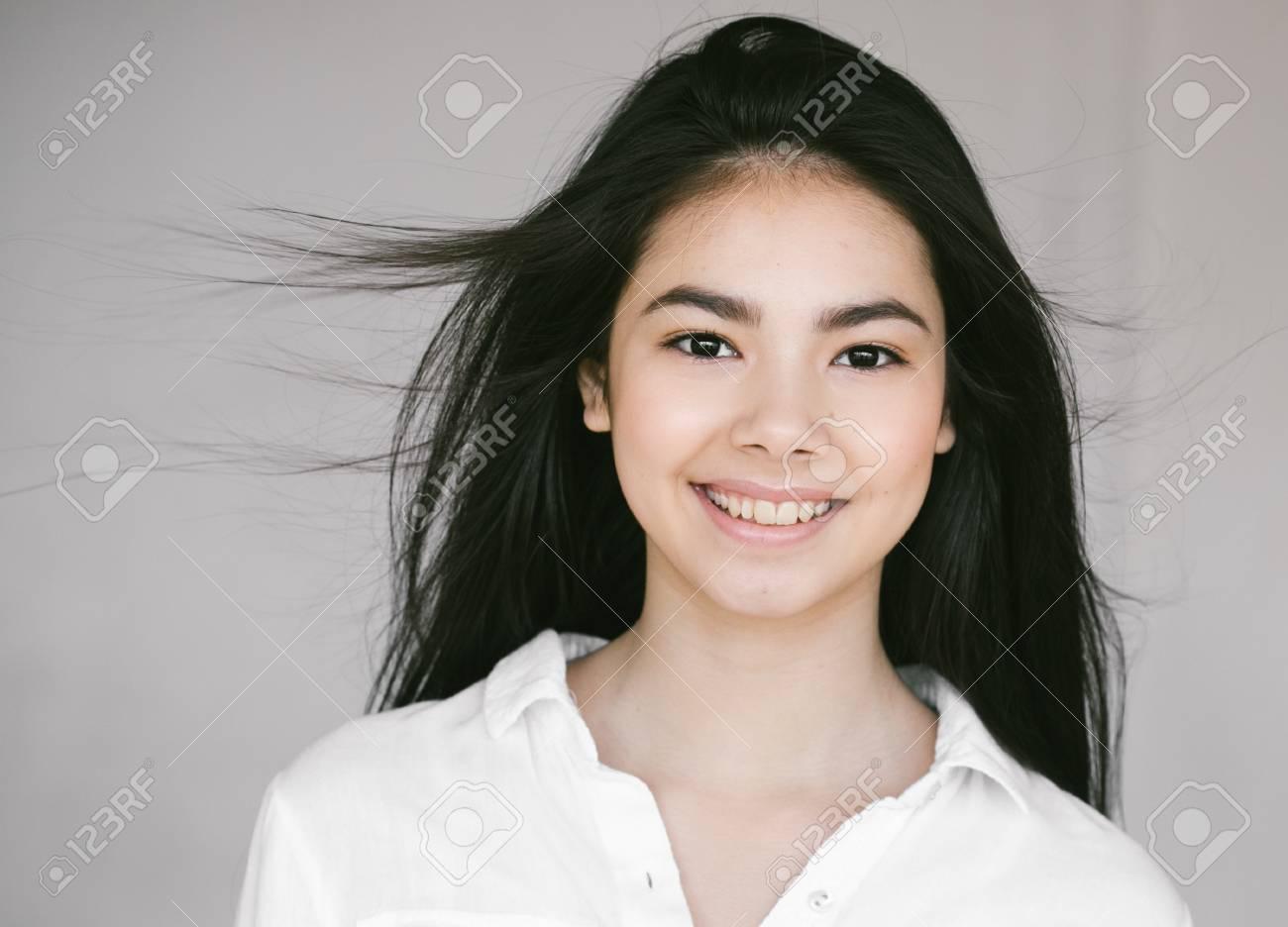 Asian woman girl beauty portrait. Studio shot. Gray background. - 79418152