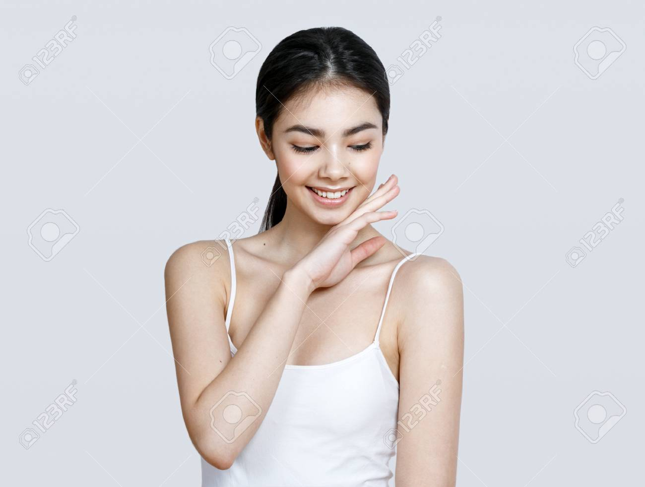 Asian woman girl beauty portrait. Studio shot. Gray background. - 79426795