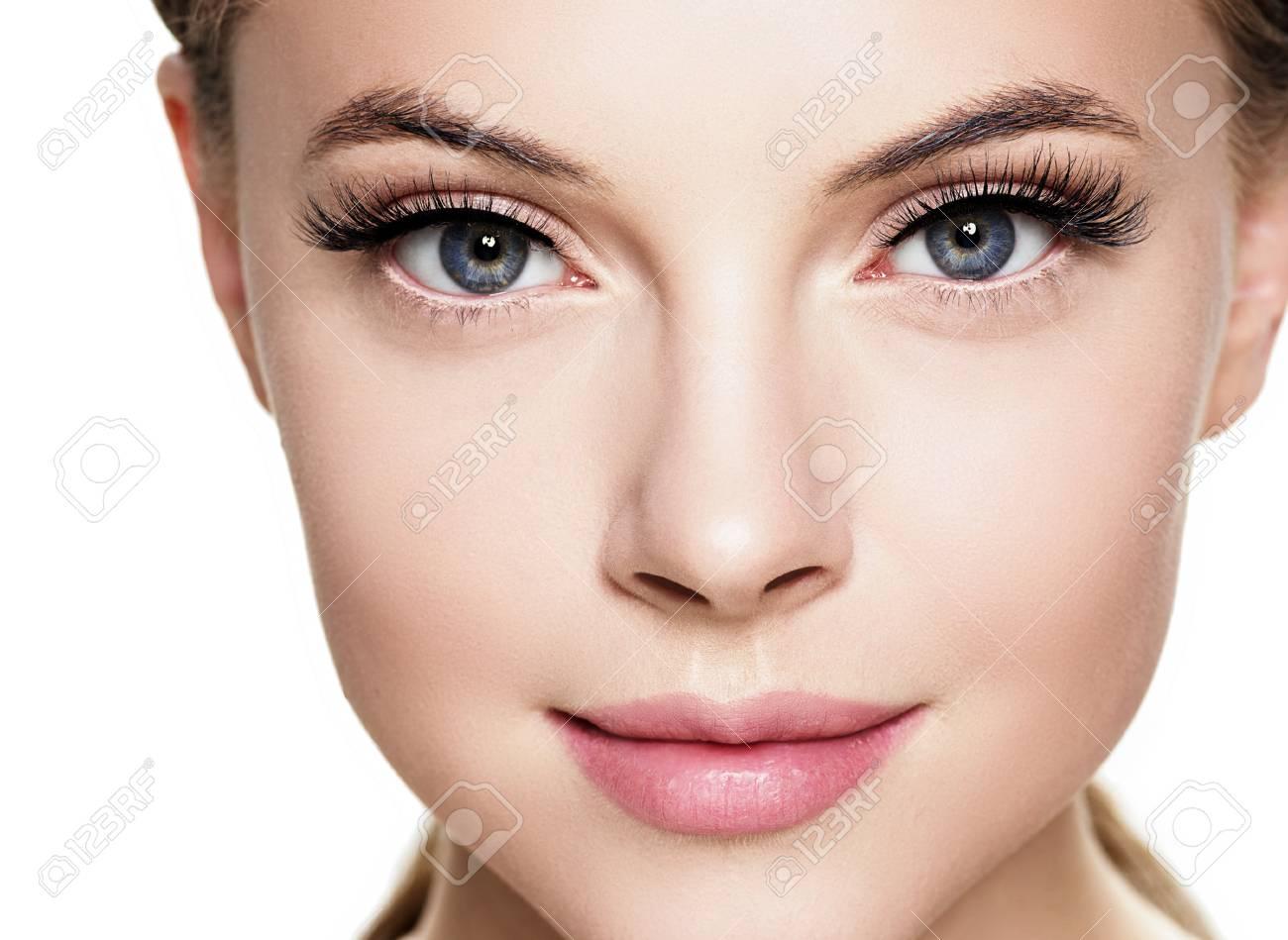 Beautiful woman face with eyelashes beauty healthy skin natural makeup. Studio shot. - 115672425