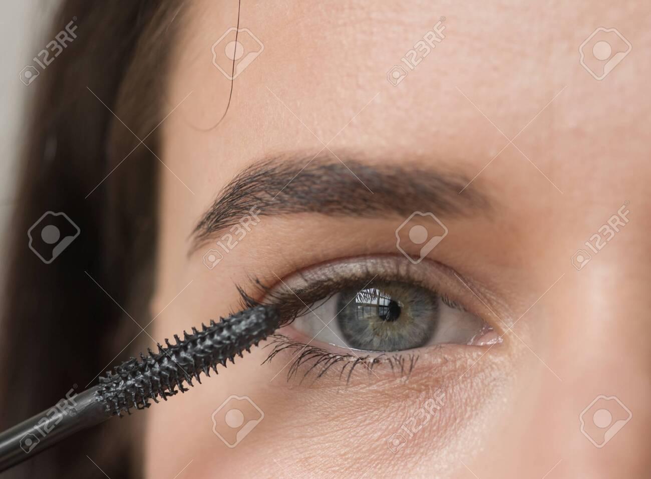 Woman makeup mascara eyes healthy skin natural fashion makeup. Studio shot. - 143599101