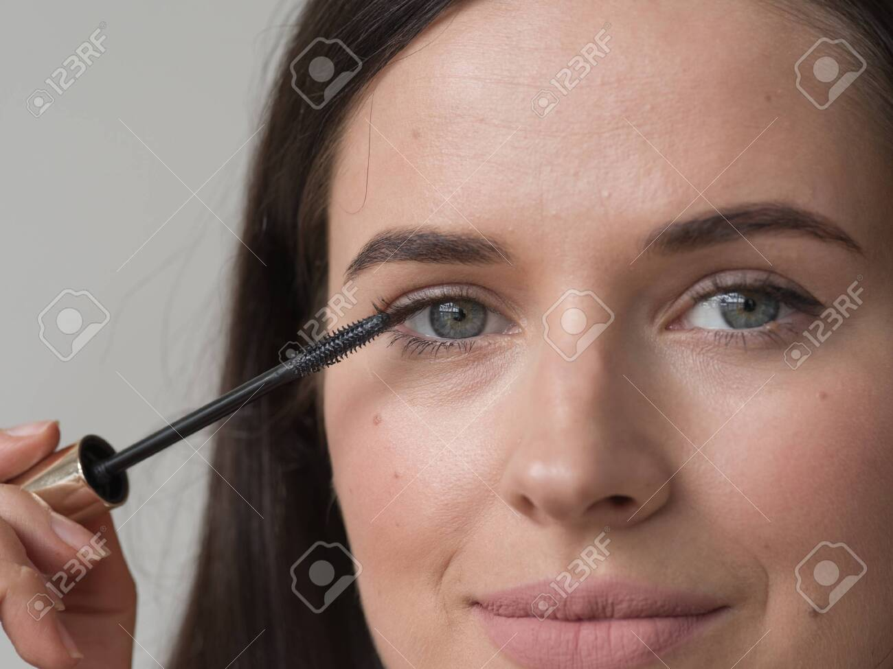 Woman makeup mascara eyes healthy skin natural fashion makeup. Studio shot. - 143642487