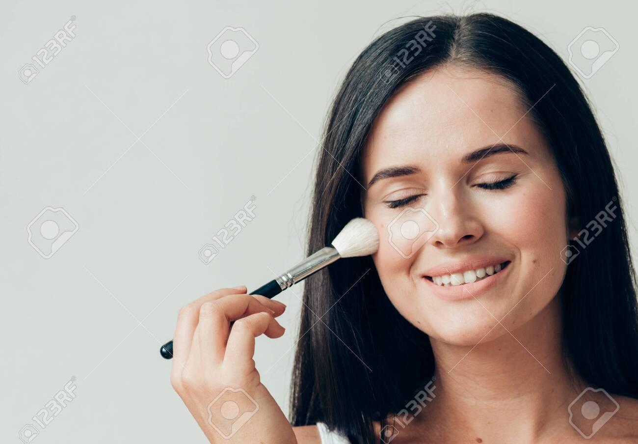 Brush makeup woman face healthy skin natural make up powder. Studio shot. - 143648050