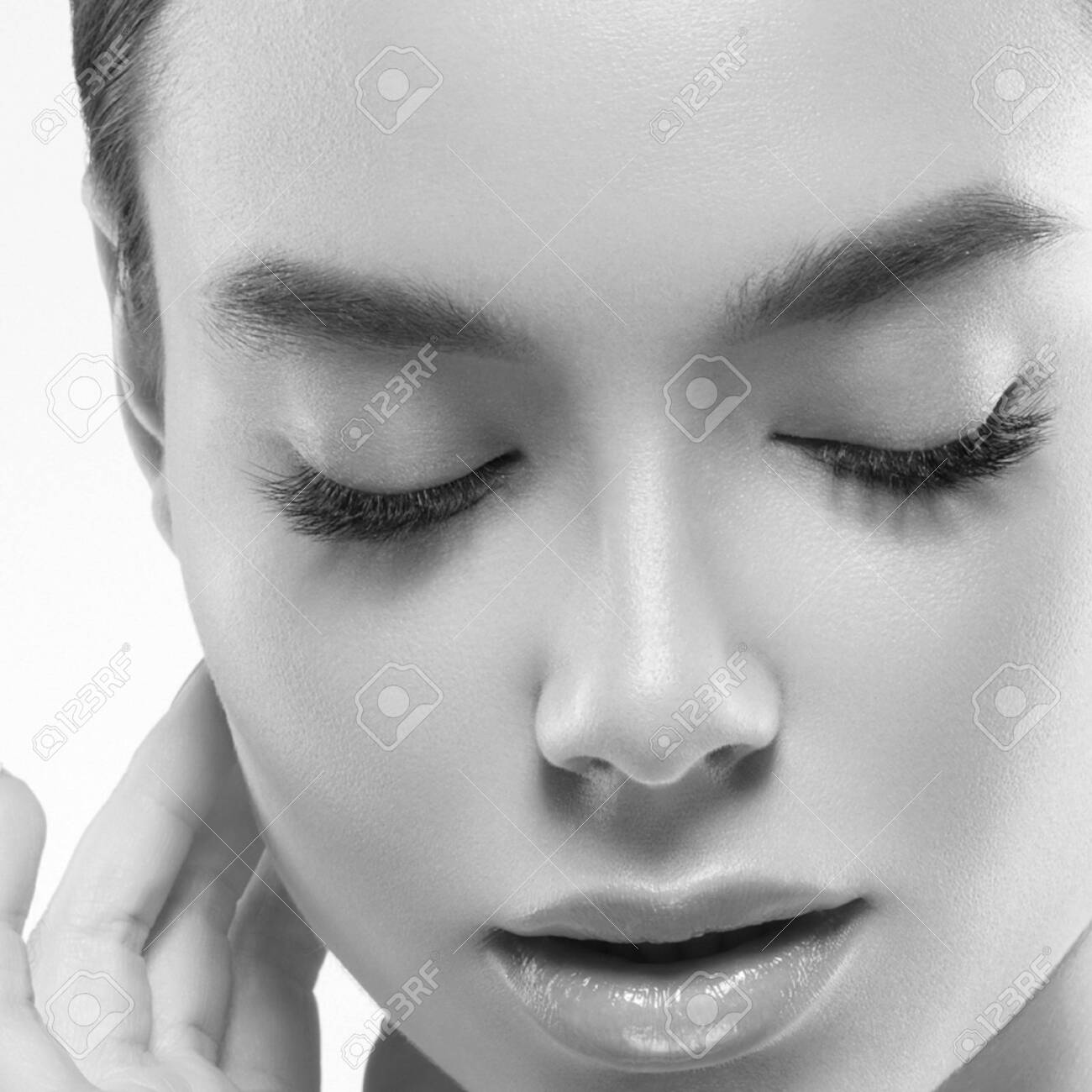 Asia beauty woman healthy skin face clean fresh skin spa. Studio shot. Monochrome. Gray. Black and white. - 143647243