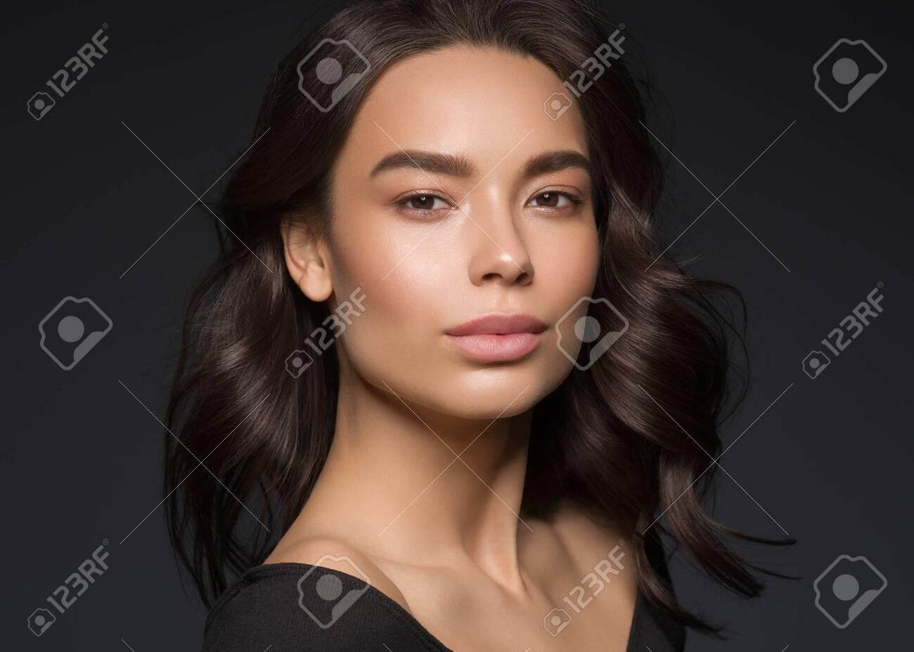 Asian beauty female black background curly black hair natural make up. Studio shot. - 143647655