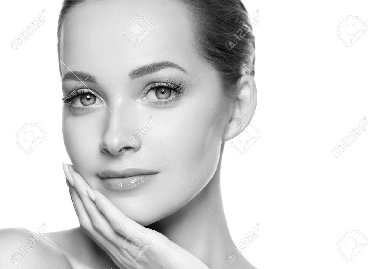 Woman beauty face healthy skin natural makeup beautiful young model. Studio shot. Monochrome. Gray. Black and white. - 143774677