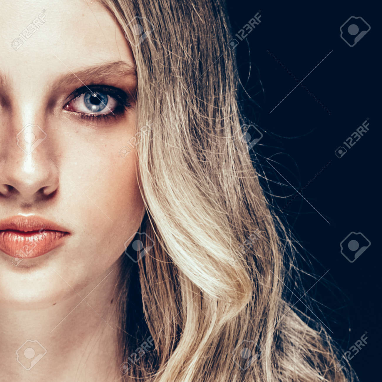 Beautiful Blonde Woman Beauty Model Girl with perfect makeup and hairstyle over black background. - 170272905