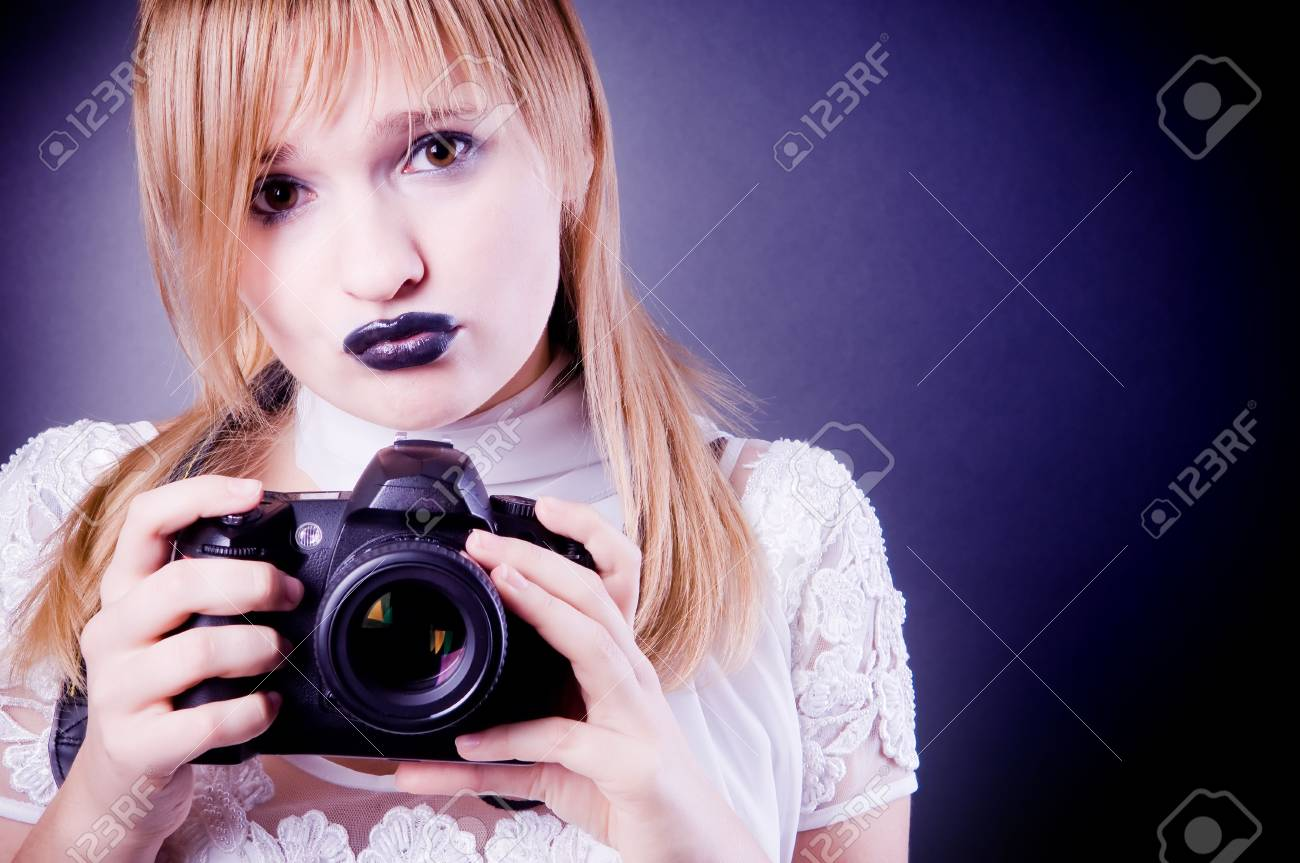 Young girl with digital camera Stock Photo - 3664405