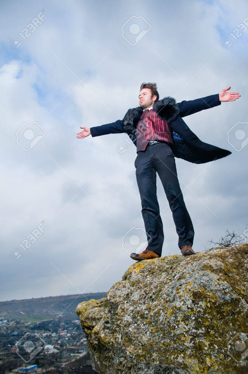 Stylish man with hands open over sky background Stock Photo - 4480739