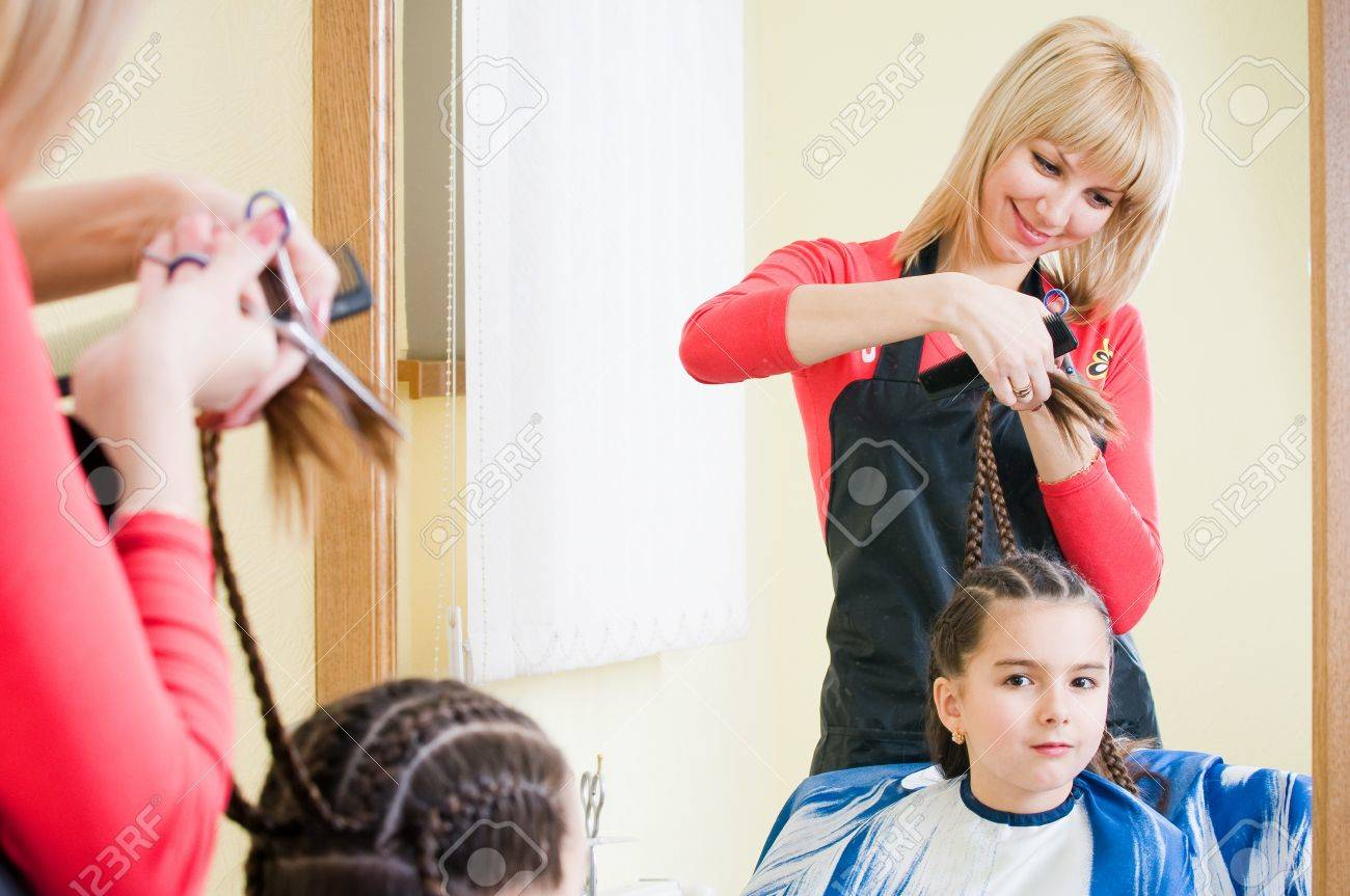 Pretty Little Girl Getting Her New Haircut In Hairdresser Salon