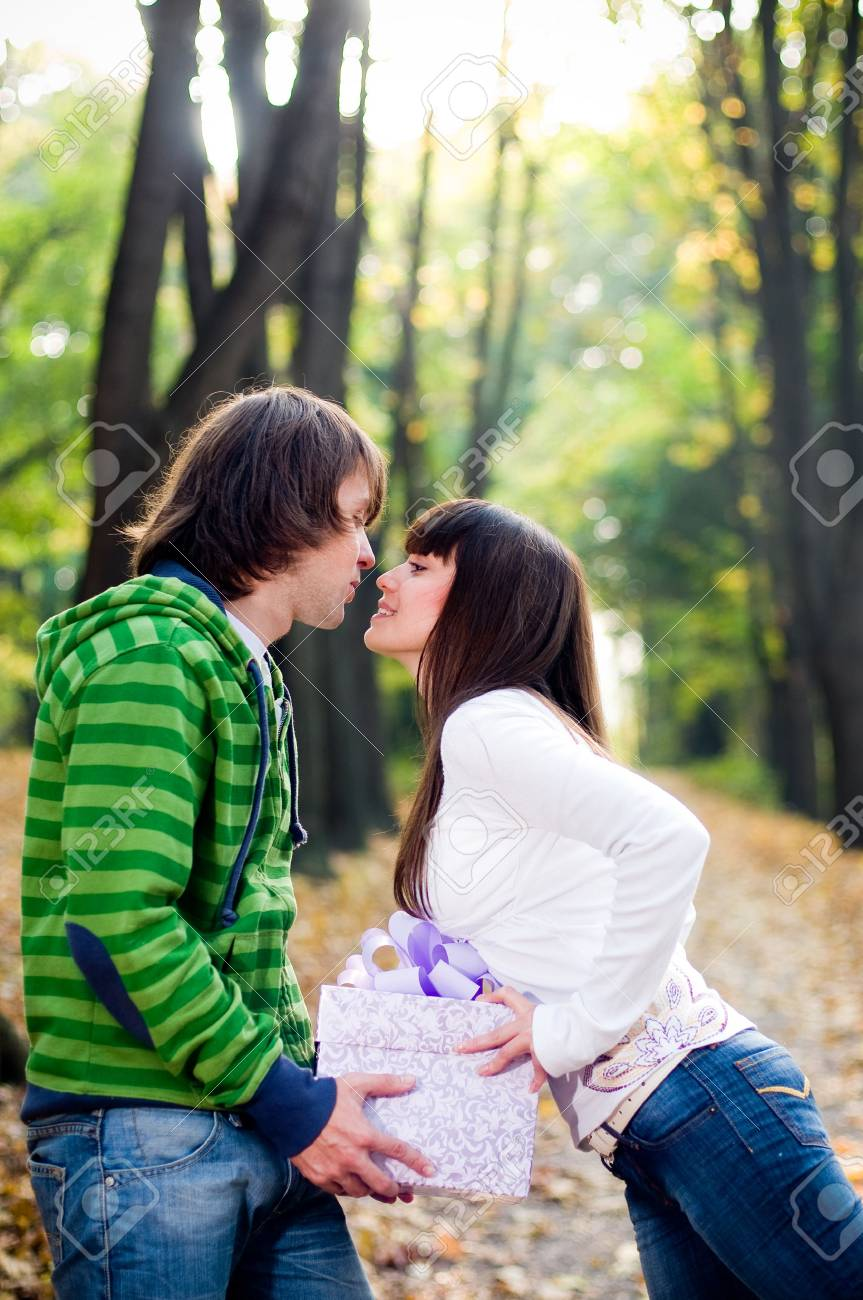Young couple kissing outside Stock Photo - 4549179