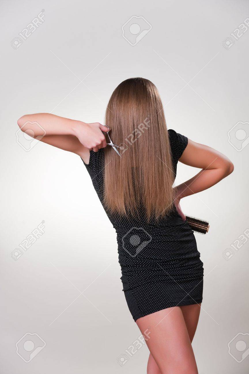 Young unrecognizable girl cutting hair Stock Photo - 6387423