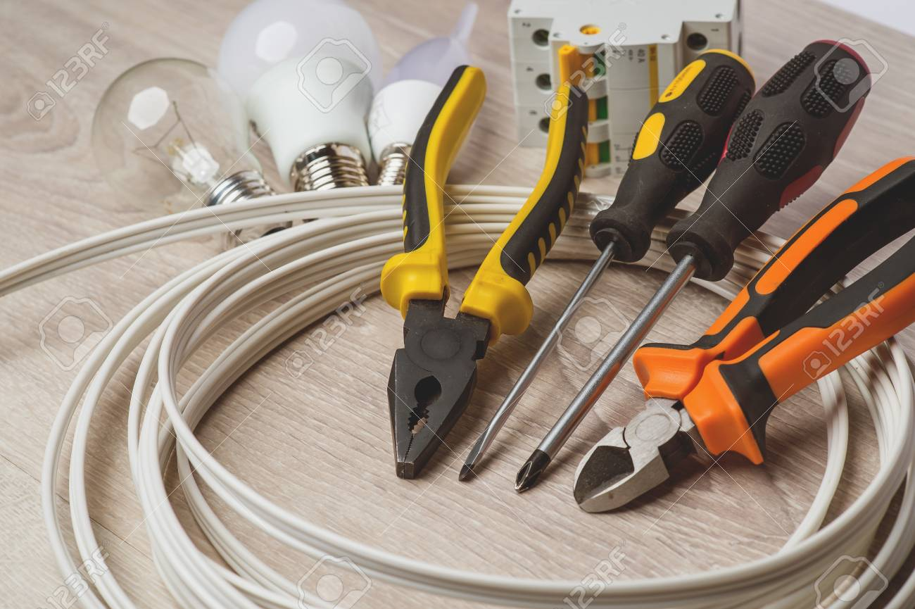 a set of tools electrician a coil of wire and equipment on a rh 123rf com Wire Removal Tool Crimping Tool