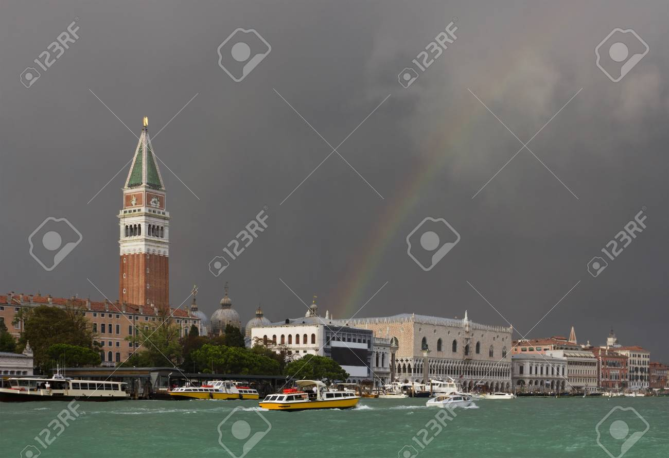 After a huge storm, the colorful rainbow spreads over St. Mark's Square in Venice, Italy illuminates the landscape with a sense of hope of a better weather. Stock Photo - 17583178