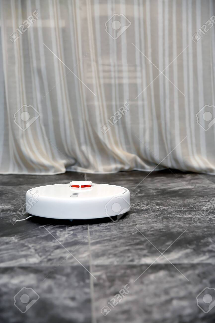 Working Robot Vacuum Cleaner Gray Tiles Porcelain Tiles Stone Stock Photo Picture And Royalty Free Image Image 142291696