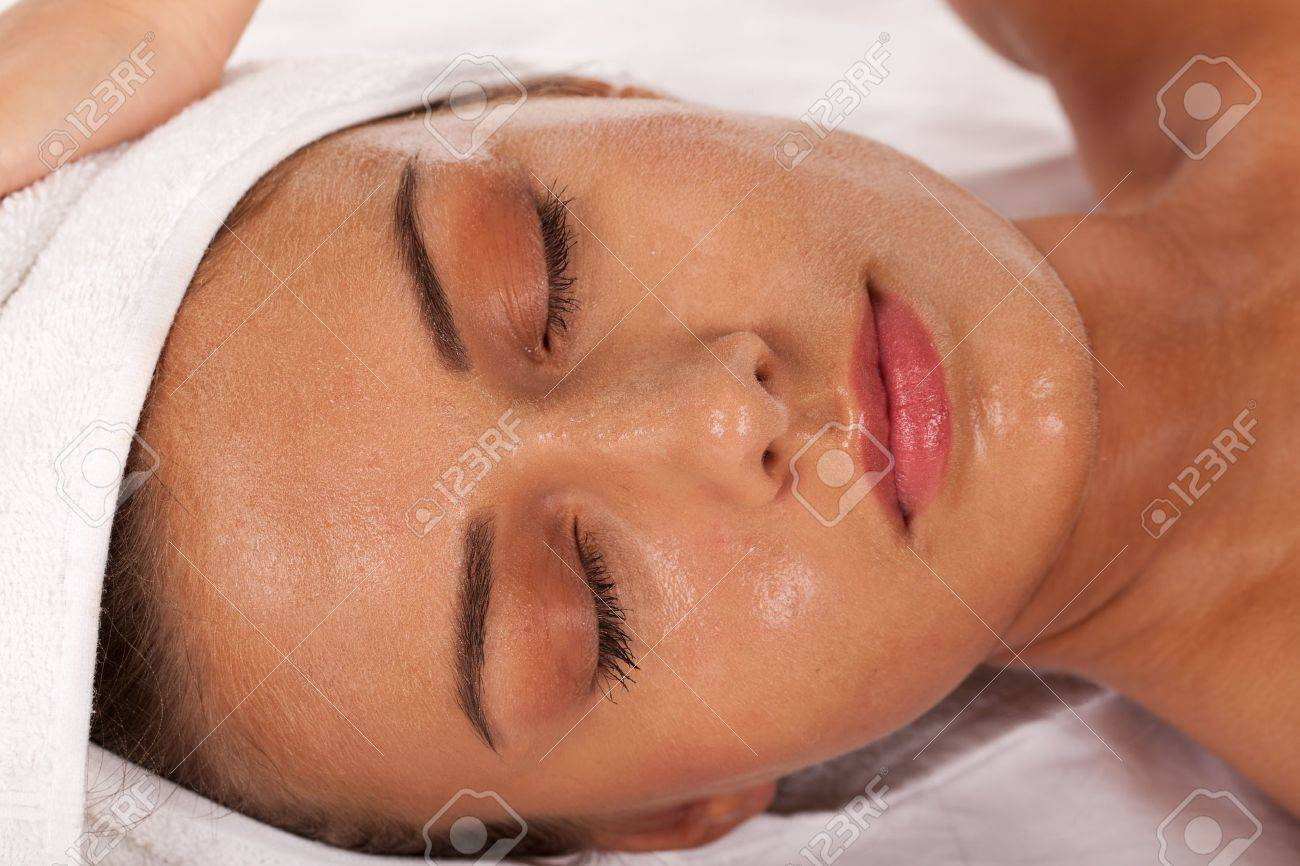 Young girl with beads of perspiration in SPA center. Stock Photo - 10893501