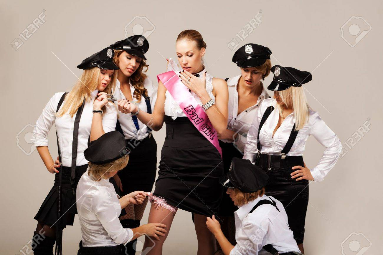 Party mates playing police officers Stock Photo - 11240445