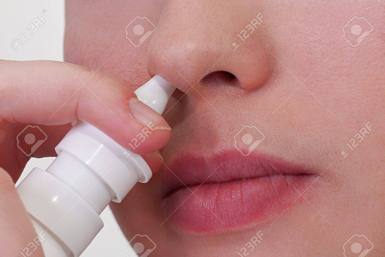 Close-up of unrecongizable woman who about to use nasal spray Stock Photo - 12194323