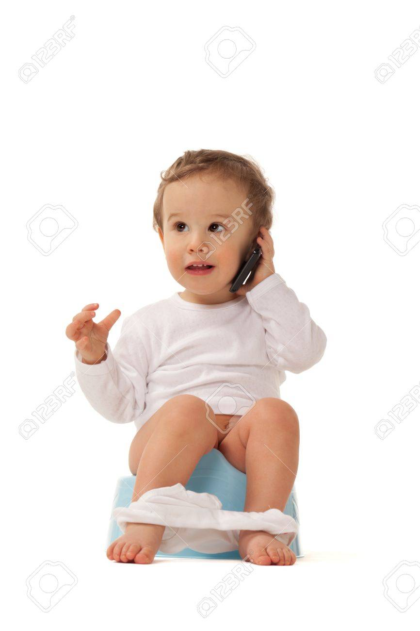 Boy sitting on a chamber bot playing with smartphone Stock Photo - 12874632