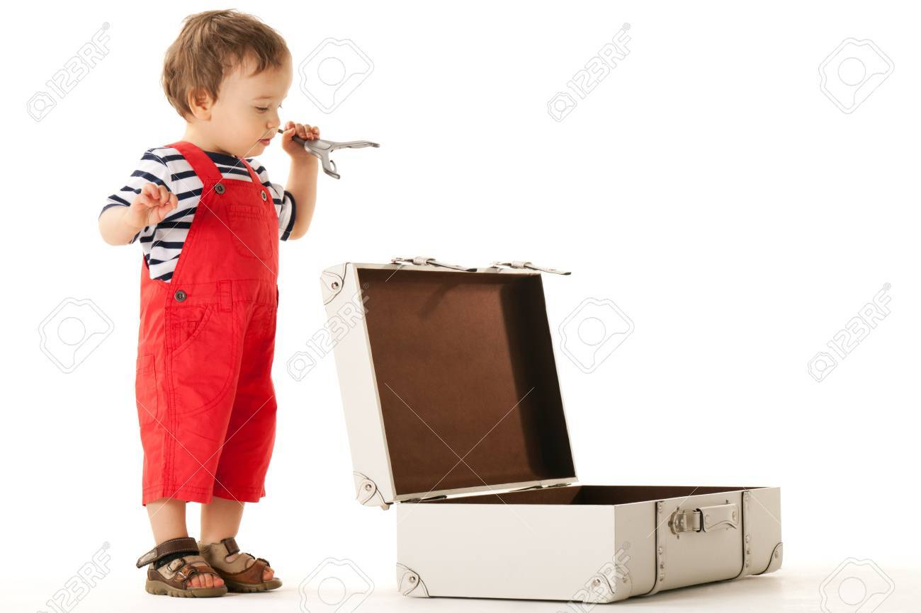 Little boy packing stuff for vacations Stock Photo - 13183676