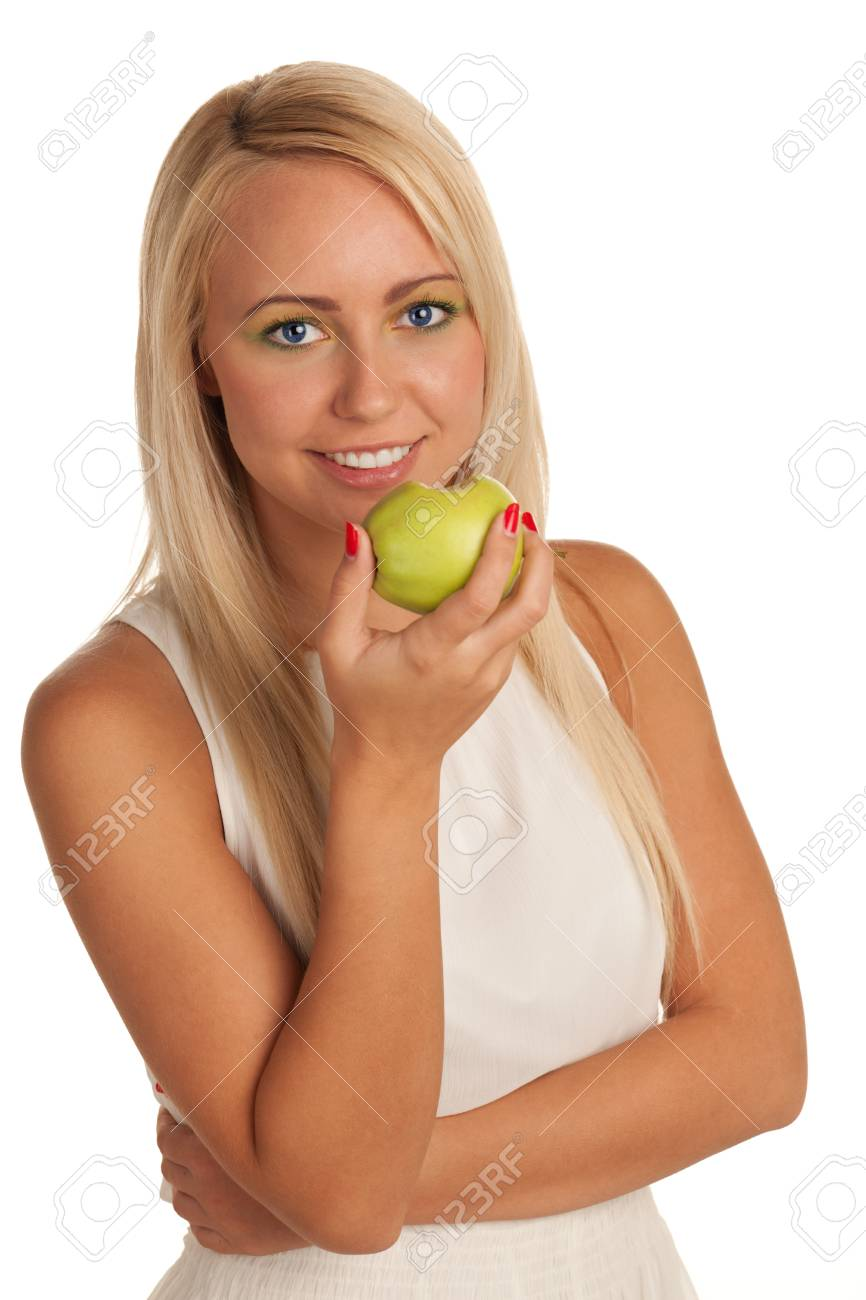 Smiling young blond girl eating apple Stock Photo - 13423506