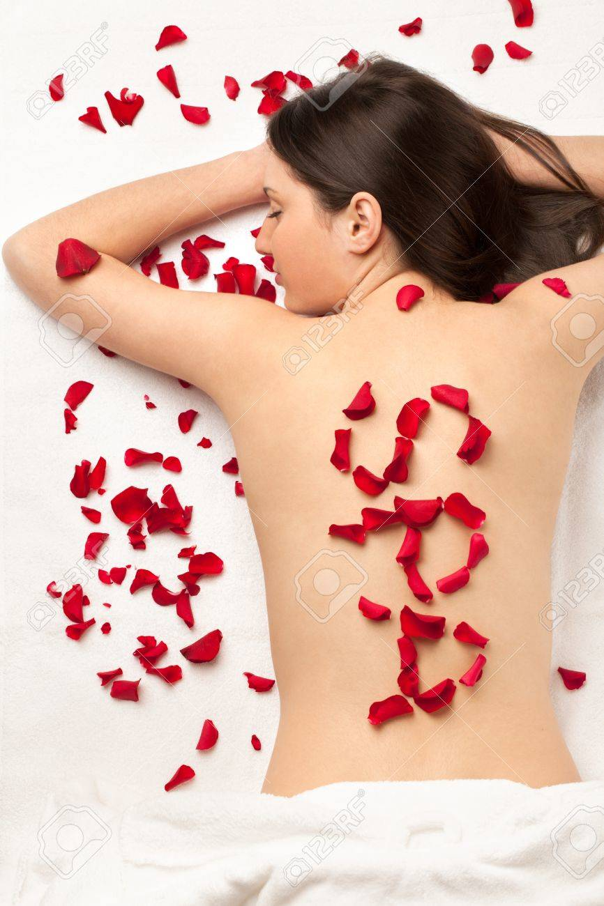 Girl with word SPA made of roses Stock Photo - 14616153
