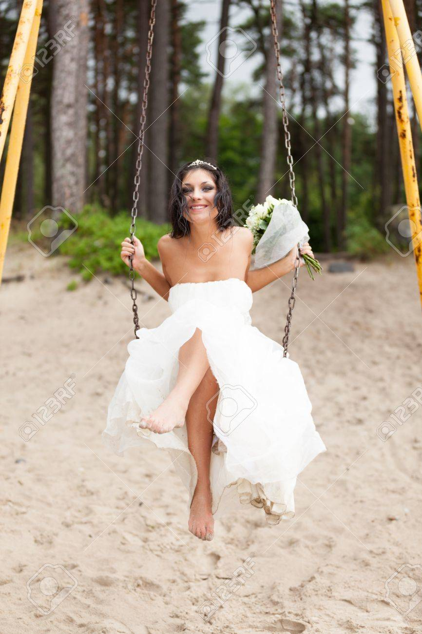 Runaway bride on a swing Stock Photo - 15202543