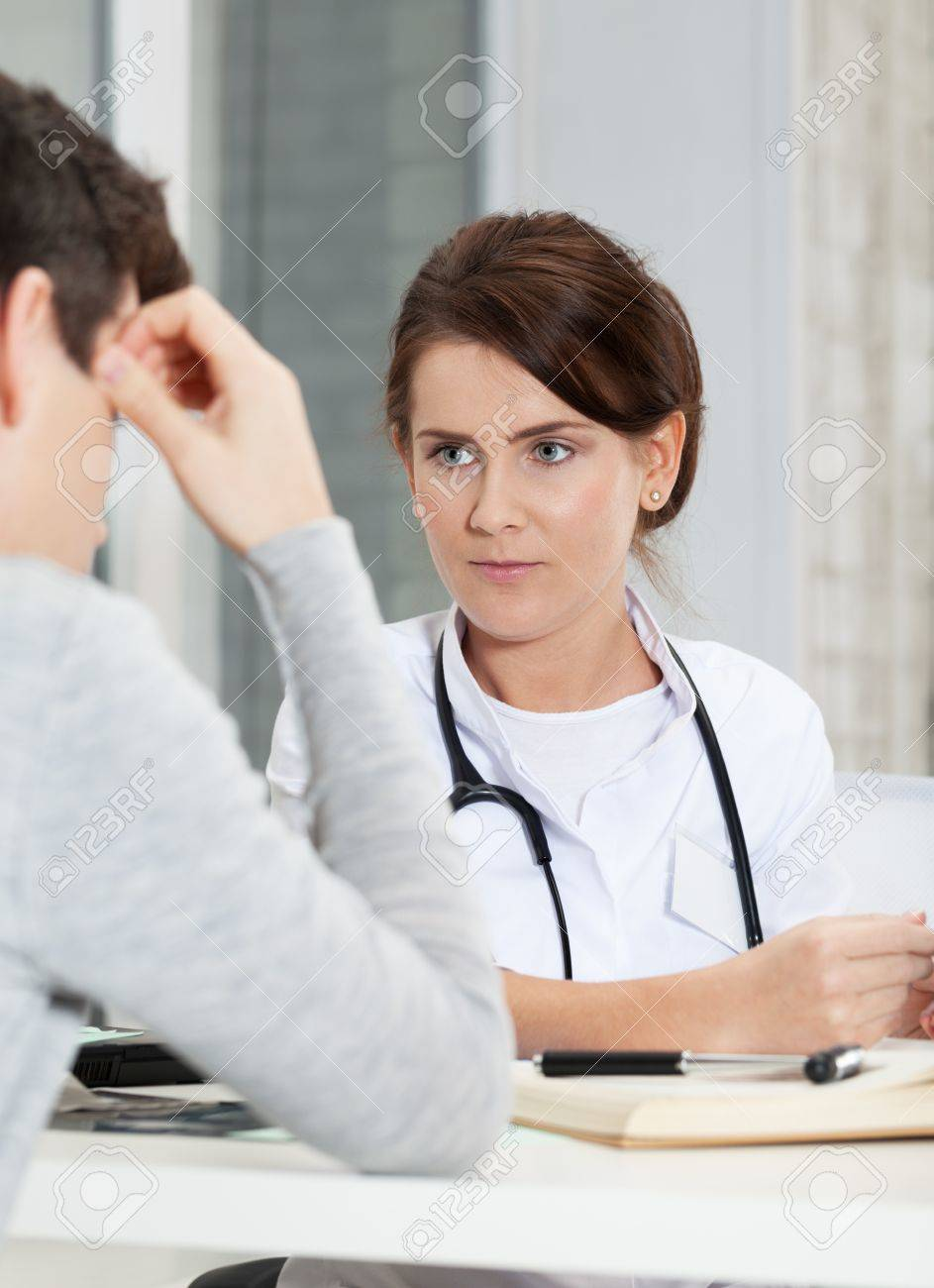 Patient explaining problem to doctor Stock Photo - 16890998