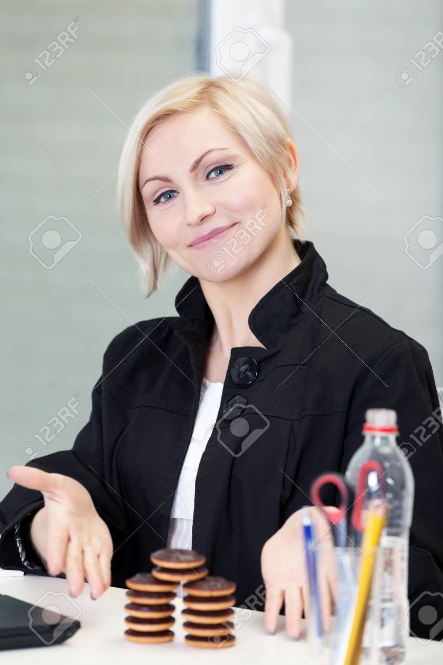 Office worker playing with cookies during lunch Stock Photo - 17453163