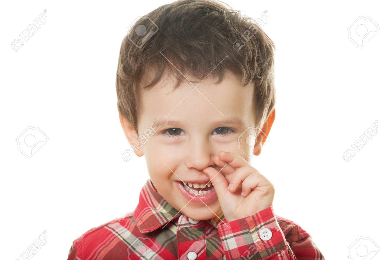 Cute boy picking nose on isolated white Stock Photo - 28500152