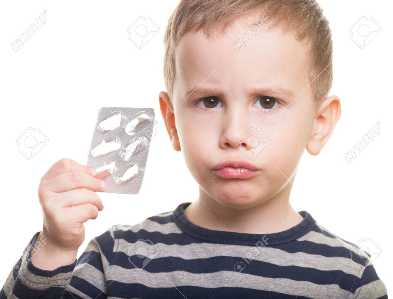 Sad kid with empty blister on isolated white Stock Photo - 38761051