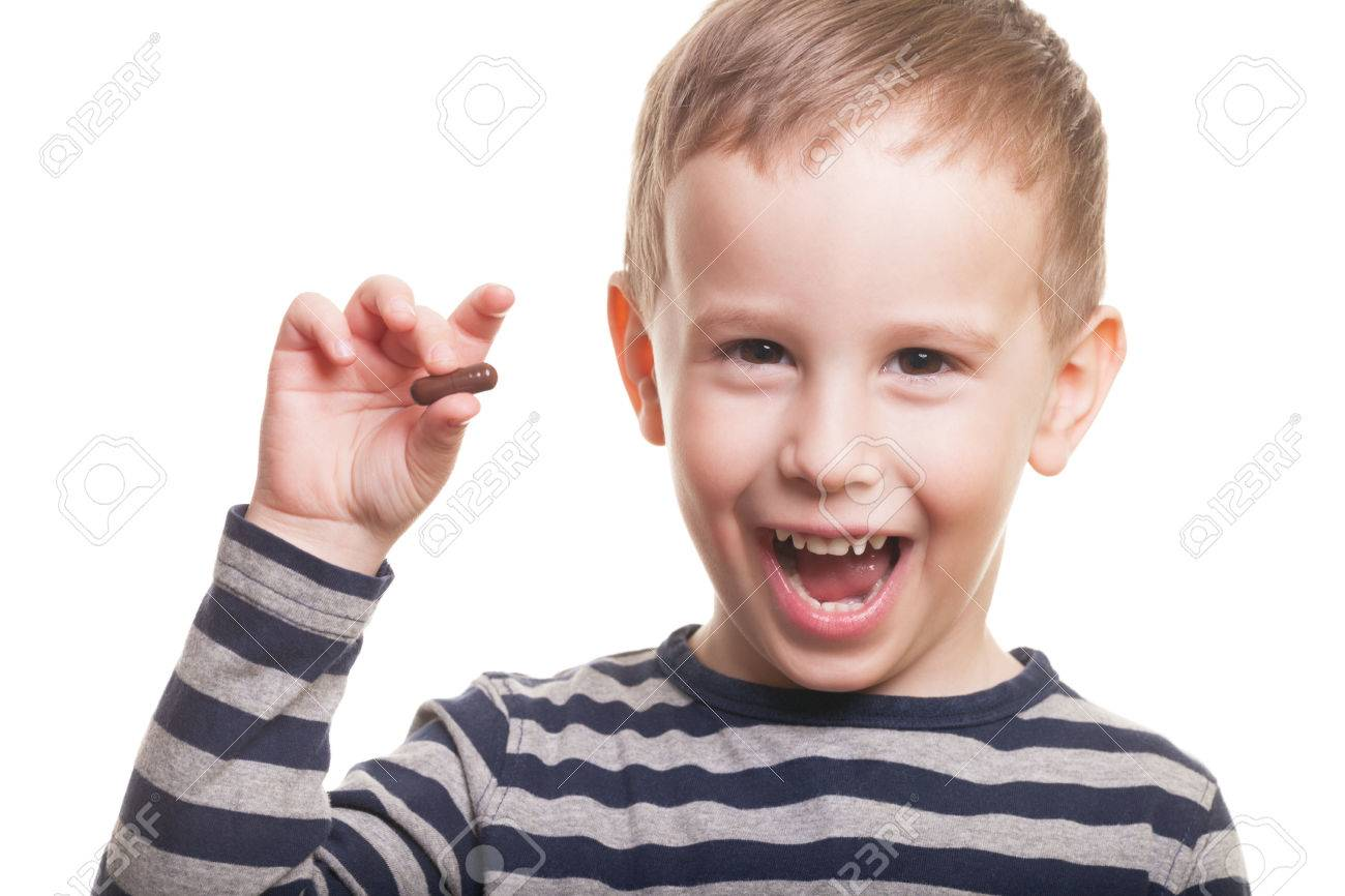 Happy boy with pill on isolated white Stock Photo - 38901359