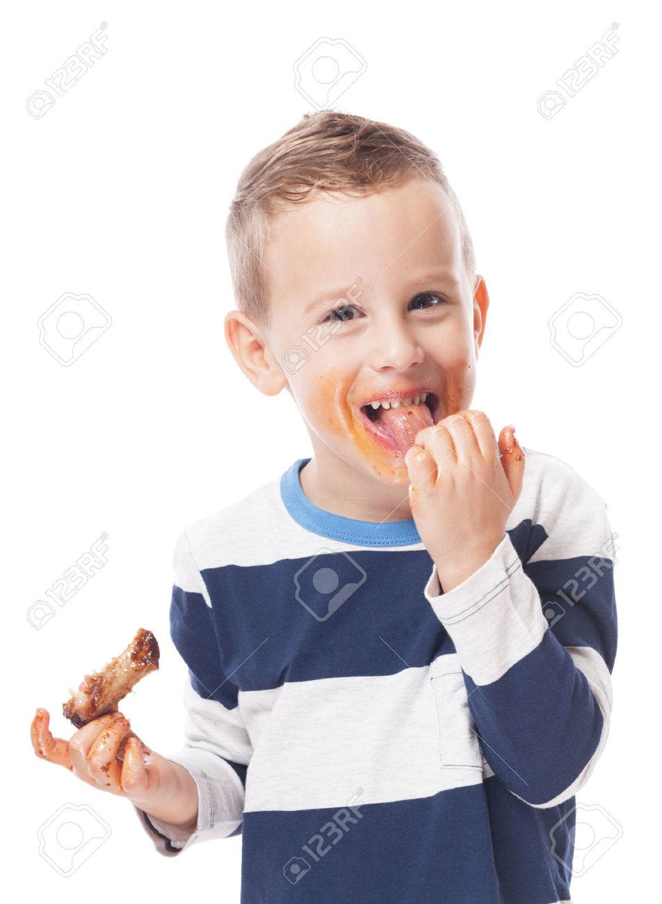 Adorable kid eating bbq ribs on isolated white Stock Photo - 46169602