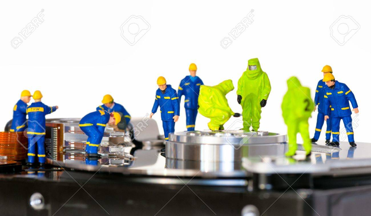 Team of technicians repair hard disk. Hard Drive repair concept Stock Photo - 11272791