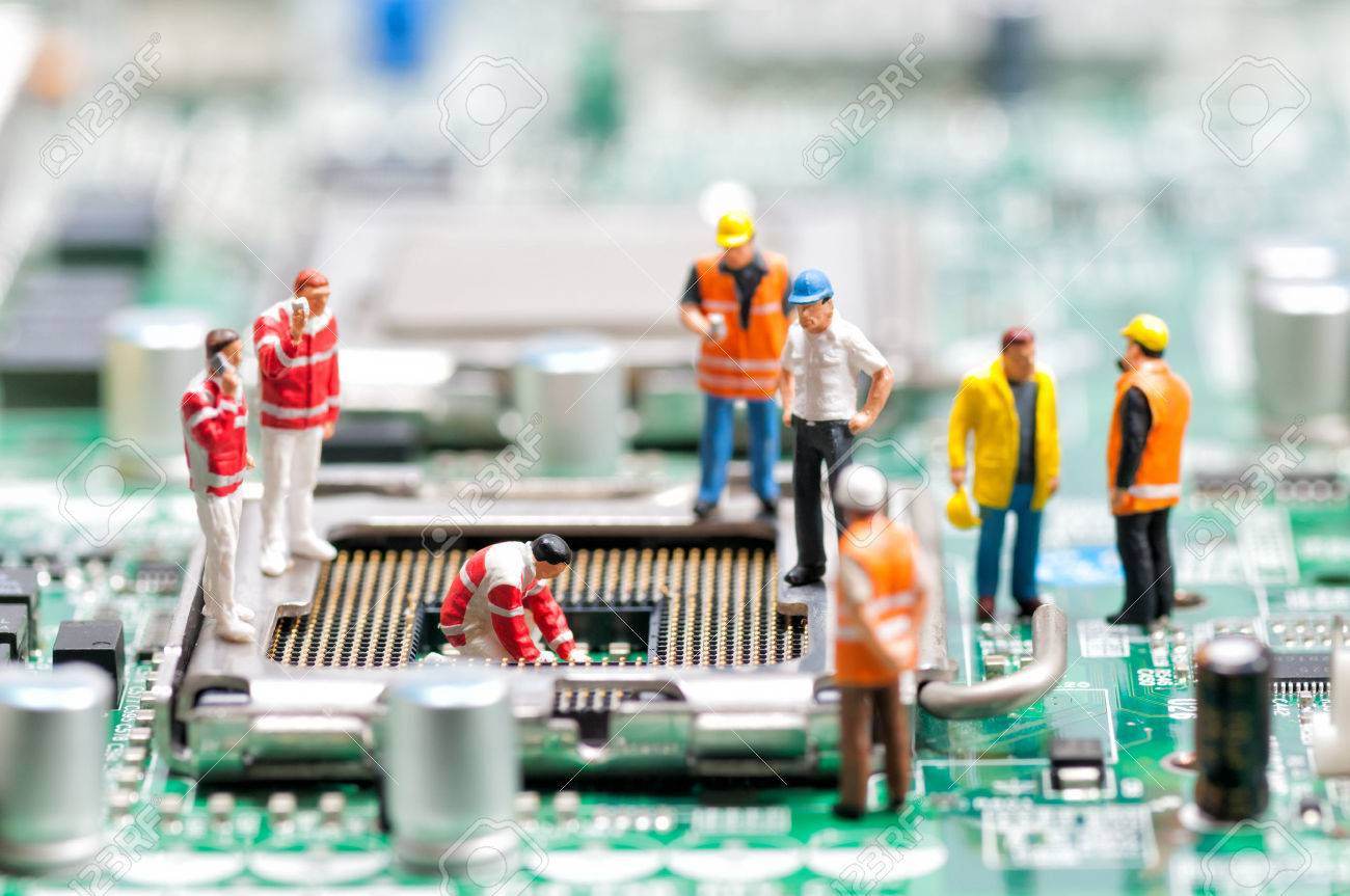 stock photo team of engineers repairing circuit board computer repair concept