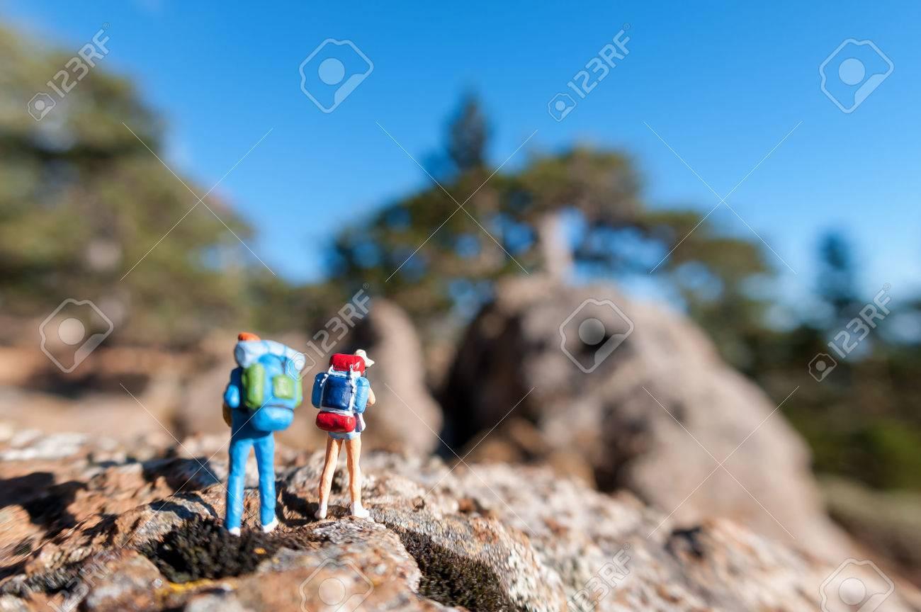 Miniature tourists with backpack. Standard-Bild - 29608215