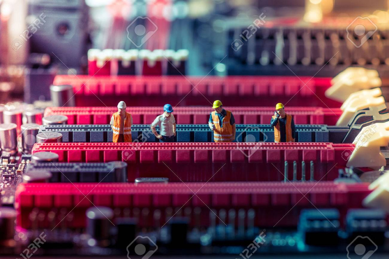 Miniature engineers repairing circuit board. Technology concept - 39221565