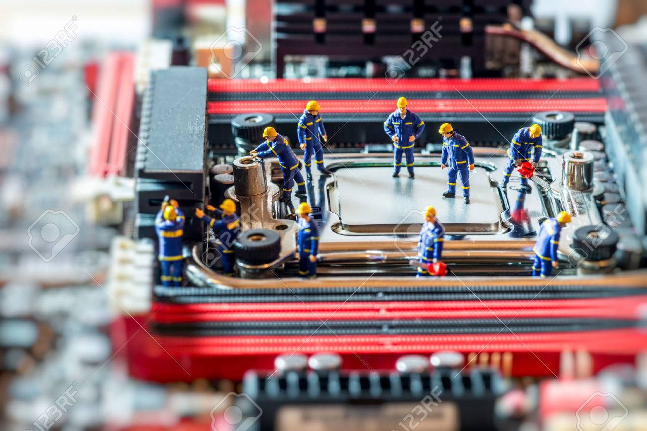 Group of Technicians repairing CPU. Technology concept. Macro photo Standard-Bild - 40577491