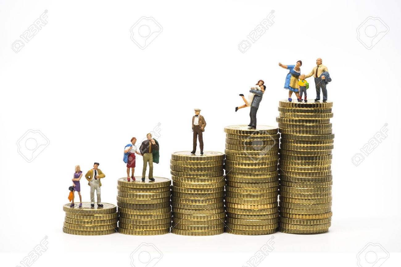Faily budget concept. Miniature family on coins pile. Macro photo Standard-Bild - 56220838