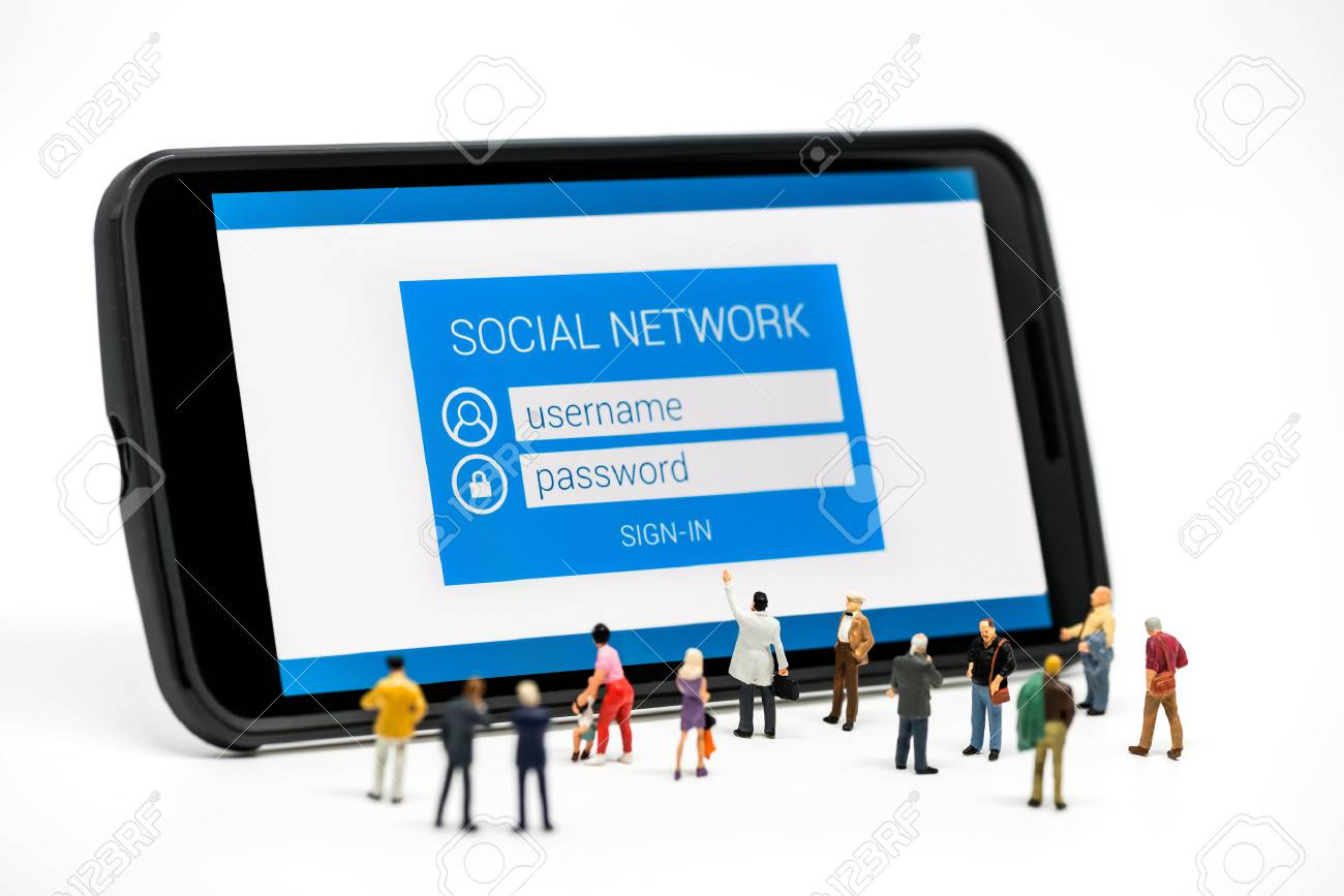 Group of people watching at social network sign in page on smartphone. Macro photo - 56221037