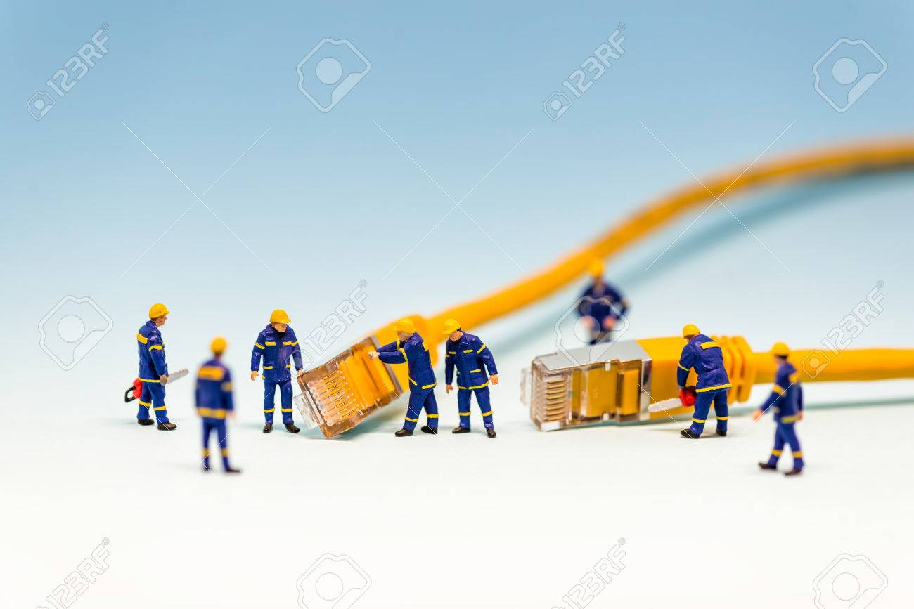 Team of techs with RJ45 network cable. Macro photo - 58447968