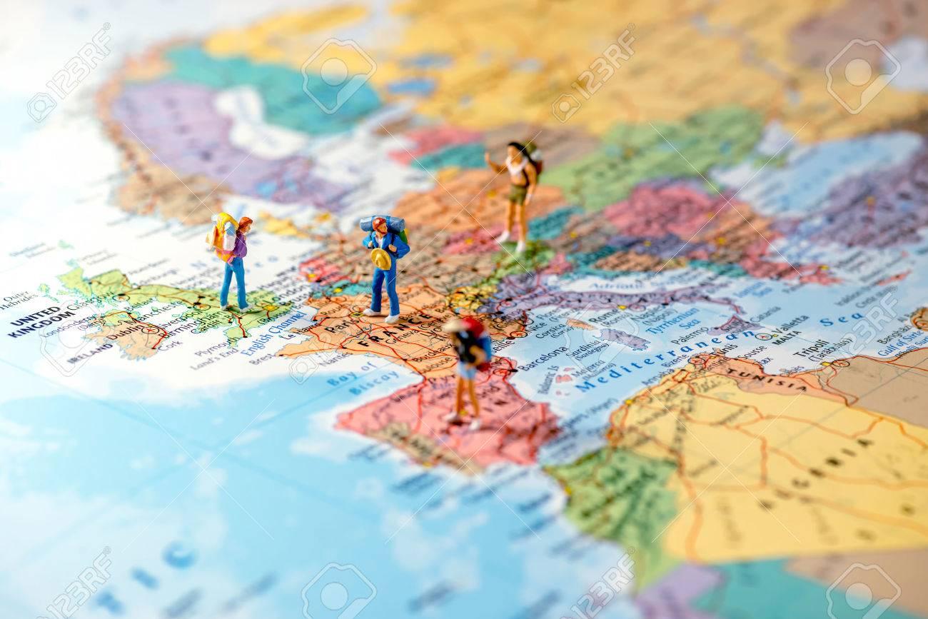 Miniature friends planning euro trip. Macro photo. - 60805854